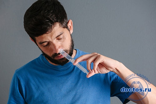 Промывание носа шприцом